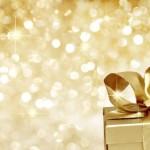 Golden gift on defocused lights background